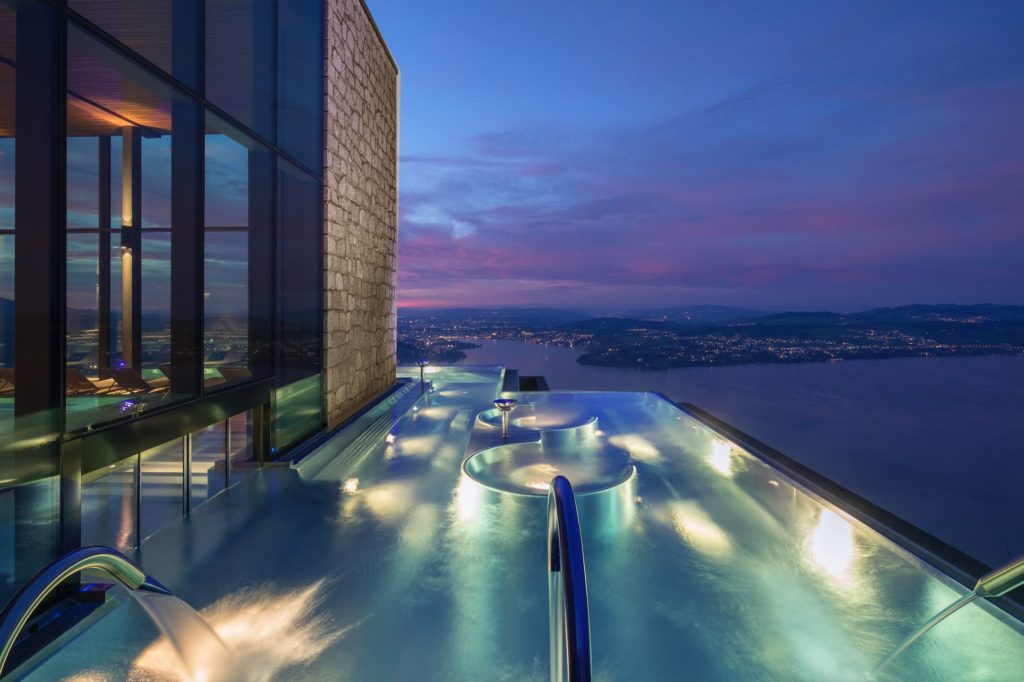 Night time view from the Spa Infinity Edge Pool at Burgenstock Resort