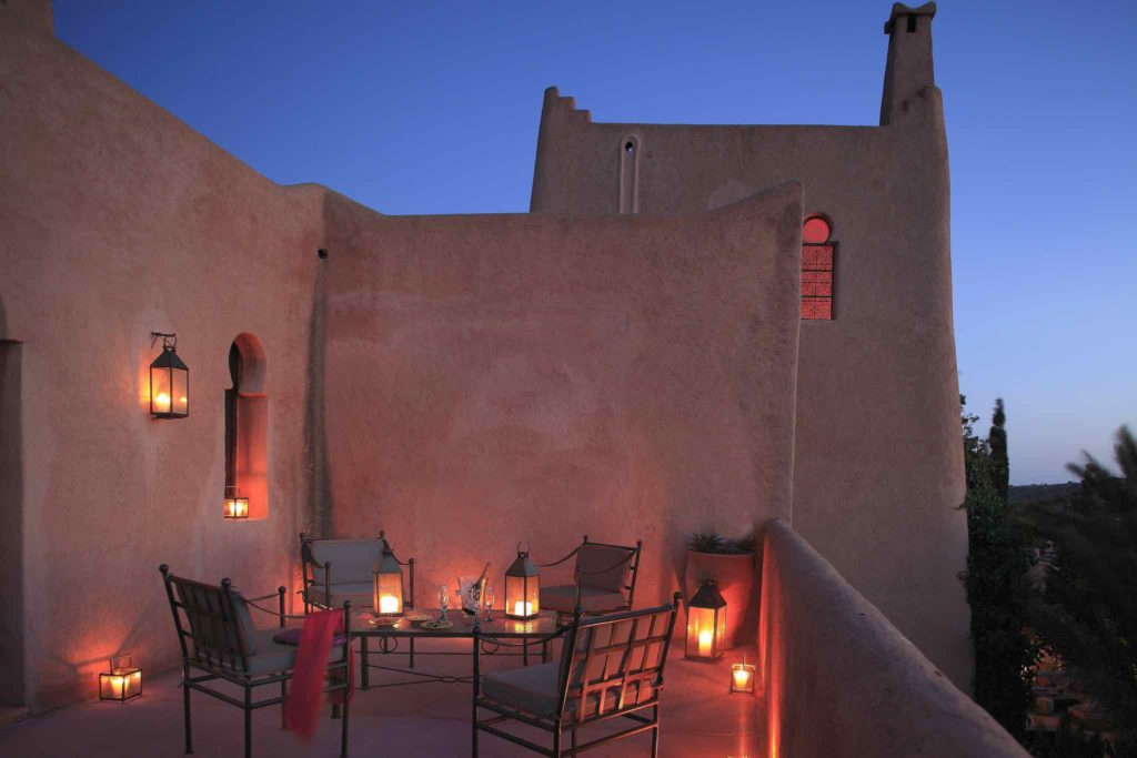 A tranquil balcony at night at the Jardin Des Douars in Morocco